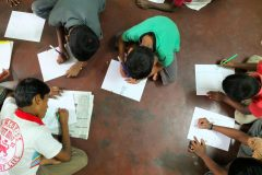 Children-studying-at-boys-shelter