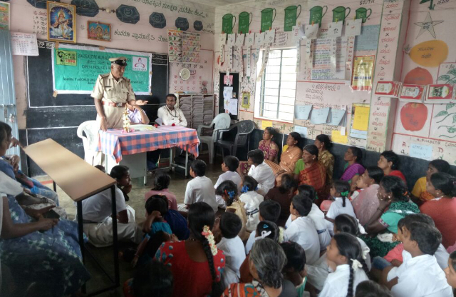police inspector is conducting awareness program in school